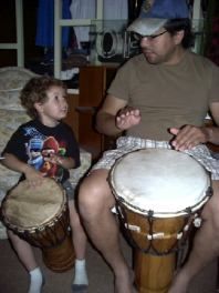 Max and his dad take a hand drumming lesson